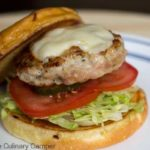 Healthy chicken burger with cheese.