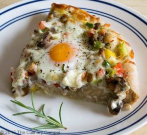 Breakfast pizza slice.