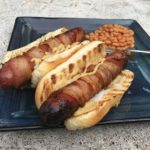 Bacon wrapped hotdogs with baked beans.