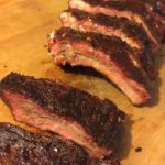 Baby back ribs smoked on a Char-Griller smoker.