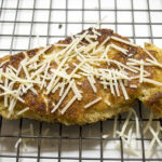 Fried chicken cutlet with fresh parmesan cheese.