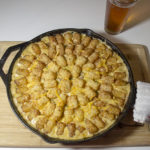 Delicious tater tot casserole served with a cold beer.