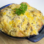 Delicious breakfast casserole with biscuits and gravy.