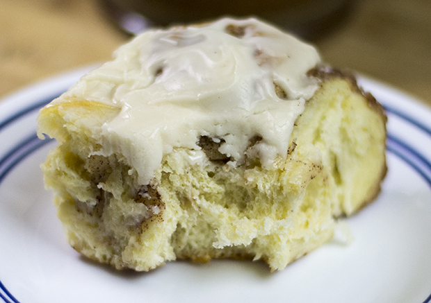 A bite of gooey cinnamon roll.