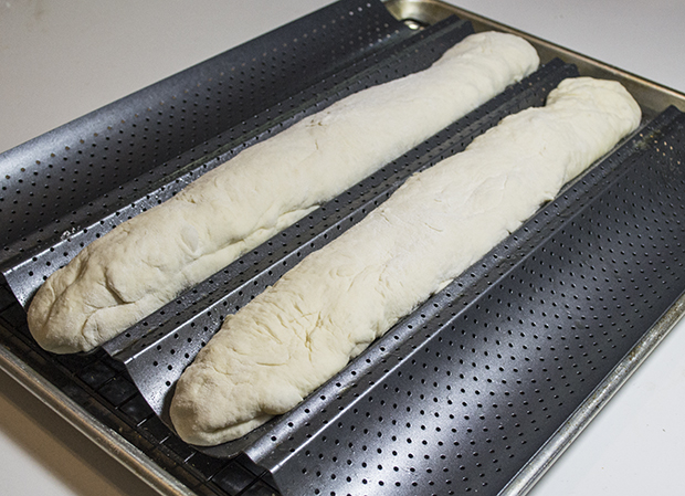 Baguettes on final rise in baguette pan.