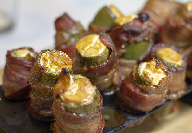 Jalapeños wrapped in bacon and stuffed with cream cheese filling.